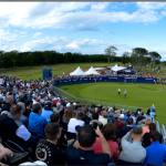 Fan loyalty on display as Golf fans seated in grandstand at the 18th hole at 2019 Scottish Open